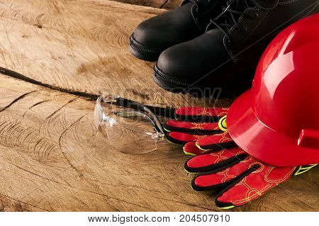 Red Safety Helmet Or Hardhat With Safety Glasses And Other Standard Safety Workwear