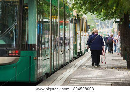 Tram stop on city street in Europe