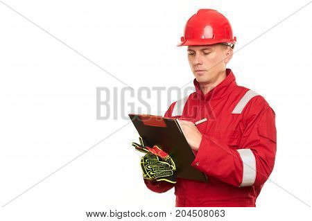 Portrait Of A Male Construction Worker Writing On Clipboard