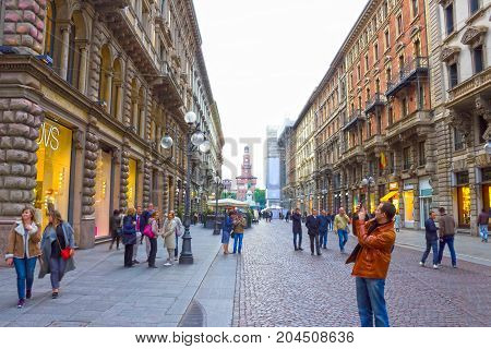 Milan, Italy - May 03, 2017: The people going at street of old architecture at Italy, Europe, Milan, Italy on May 03, 2017