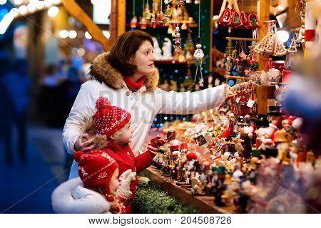 Family At Christmas Market. Xmas Winter Fair.