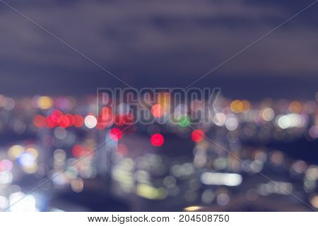 View of Tokyo city night lights blurred bokeh background Violet marsala filter on blurred defocused night lights abstract background