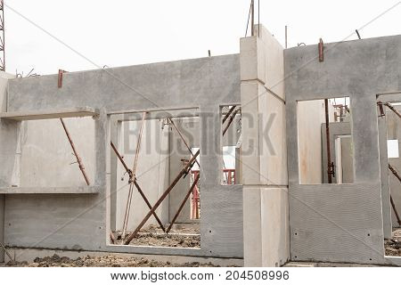 Installation of prefabricated building wall panels in construction works.