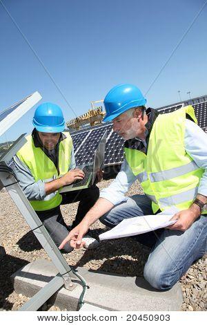 Engineers checking solar panels running