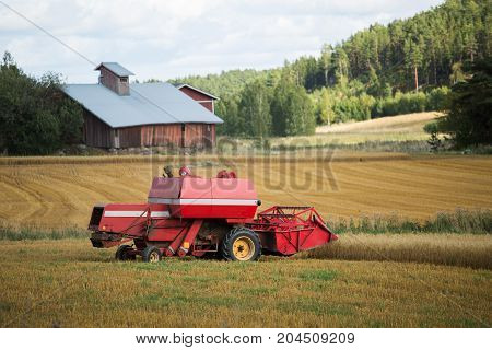 Combine harvester on a field of wheat