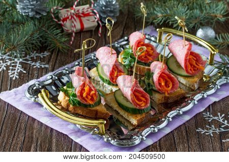 Appetizer Canape On Crispy Bread With Cucumber, Carrots And Sausage. Beautiful Christmas And New Yea