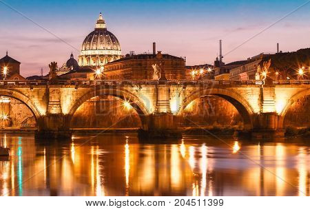 The sunset view of the Vatican with Saint Peter's Basilica and Sant'Angelo's Bridge , Rome, Italy.
