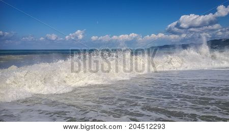 High Wave With Cloud Of Splash On Beach In Sochi