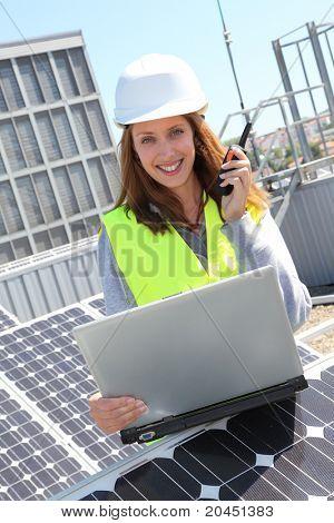 Woman engineer on solar panels site