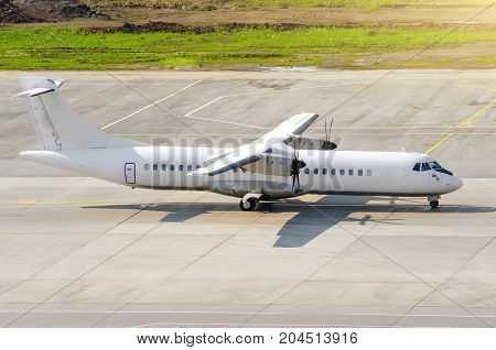 Passenger Turboprop Airplane Taxi For Takeoff At The Airport