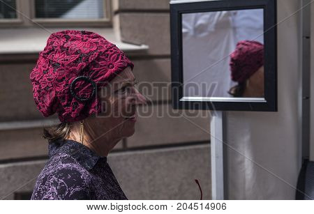 TURKU, FINLAND ON JUNE 30. Closeup view of customer´s face and old-fashioned hat in the Market. Mirror in the background on June 30, 2017 in Turku, Finland. Editorial use!