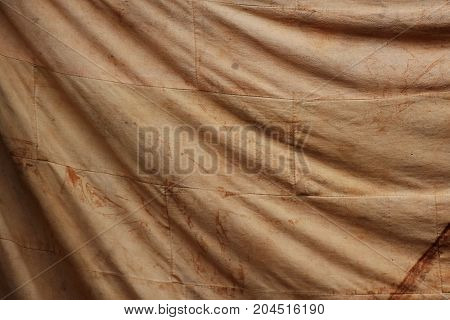 smudge on old brown cloth for background