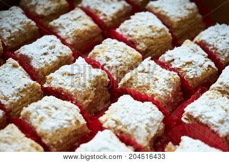 Napoleon Cake Of Puff Pastry With Sour Cream On A White Plate