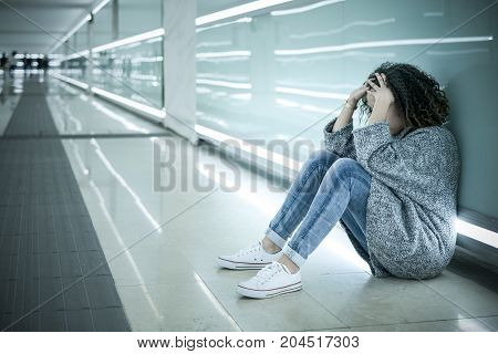 Lonely And Sad Girl Seated On The Ground