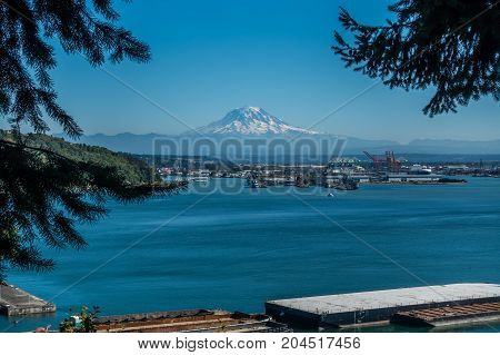 Mount Rainier rises up over the Port of Tacoma.