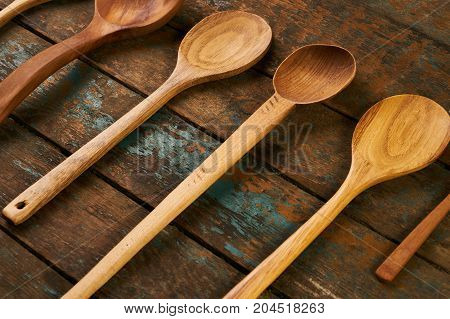 Wooden Spoon On Wooden Board Background