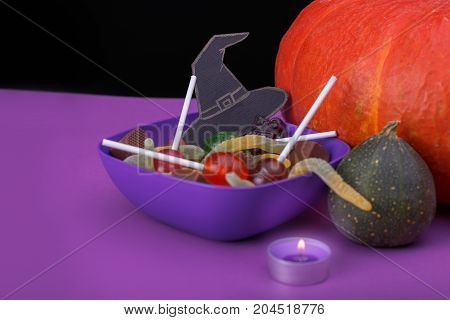 Burning candles. Cloud frame with ghost, pumpkins, spiders and bats cut out of paper. Isolated black background.