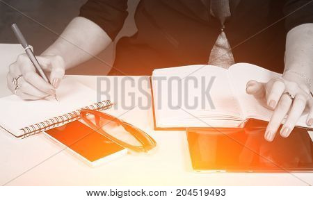 woman in business clothes writes in the notebook, concept business girl, Desk