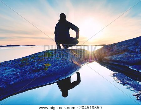 Tall Backpacker Watch Clear Sunny Daybreak Over Sea. Hiker  Hiker Enjoy Breathtaking Sunrise