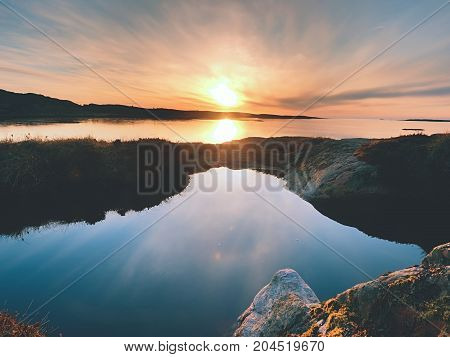 Concept Of Seascape Sunset Or Sunrise Background With Rich Reflection In Water Pool.