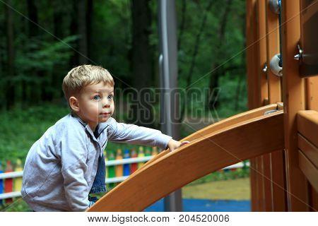 Child Climbing On Slide