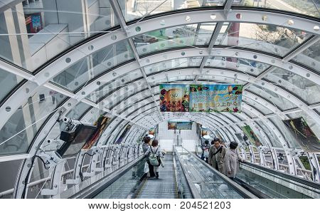 People Riding Escalators At Odaiba Island.tokyo, Japan