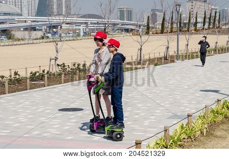Japanese Mom And Son Taking Test Trip On Hoverboard