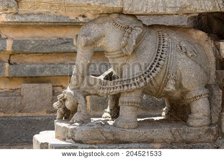 Mysore India - October 27 2013: Closeup of brown stone elephant statue supporting part of the Trikuta shrine at Chennakesava Temple in Somanathpur.