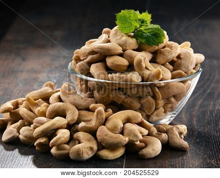 Bowl With Cashew Nuts On Wooden Table