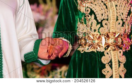 Close up of moroccon couple's hands at a wedding concept of marriage moroccan wedding