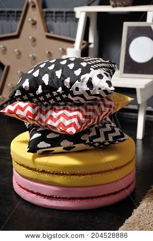 Pillows From A Children's Bed On Large Macaroons