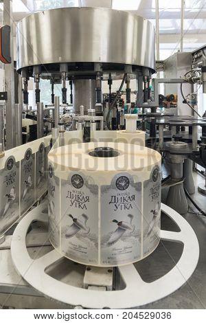 Brest, Belarus - July 05, 2017: Brest Distillery. A machine for applying labels to bottles