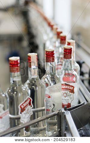 Brest, Belarus - July 05, 2017: Brest Distillery. The conveyor with bottles of vodka