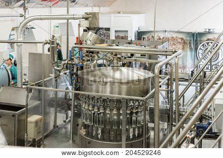 Brest, Belarus - July 05, 2017: Brest Distillery. The shop for bottling vodka, automatic filling machines