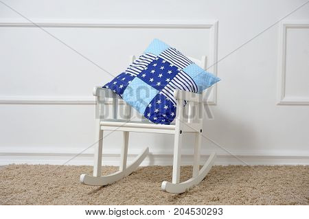 Pillow Rests On A Rocking Chair In The Children's Room