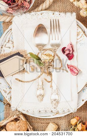 Tableware And Silverware With Dry Flowers, Top View