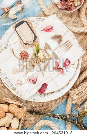 Tableware And Silverware With Dry Flowers And Decorations
