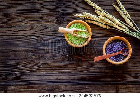 home made spa with wheat herbs cosmetic salt for bath on wooden desk background top view mock-up