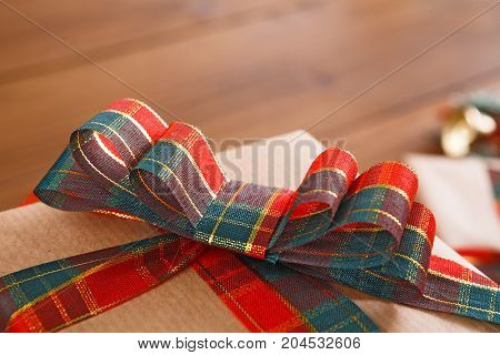 Gift box wrapped with grey paper. Xmas, new year and winter holidays concept. Crop, close up