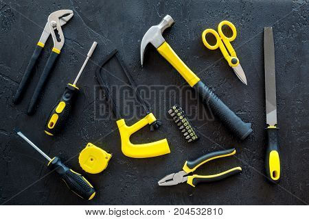 house renovation with implements set for building, painting and repair on black table background top view pattern