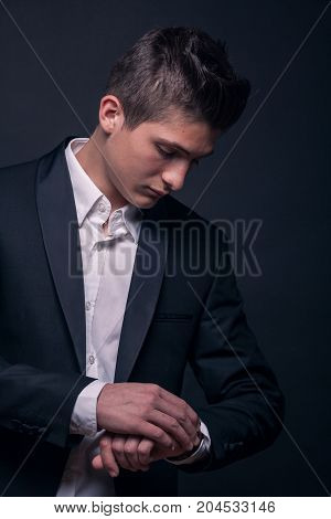 One Young Teenage Boy, Looking At Watch