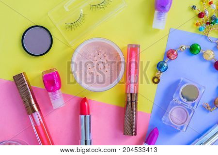 Colorful make up products material design flat lay close up scene