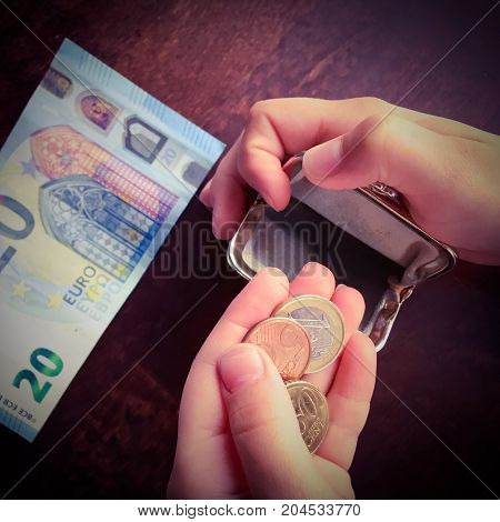close up photo of euro money and hand.
