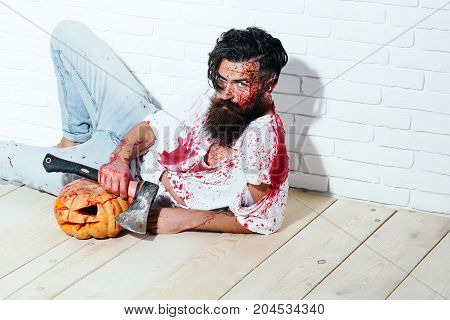 Halloween Zombie Bearded Bloody Man With Pumpkin And Axe
