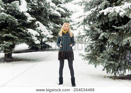 Model Warming Hands In Coat Pockets