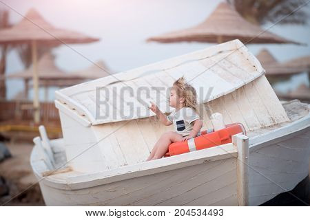 Small Kid Pointing With Pointer Finger At Beach.