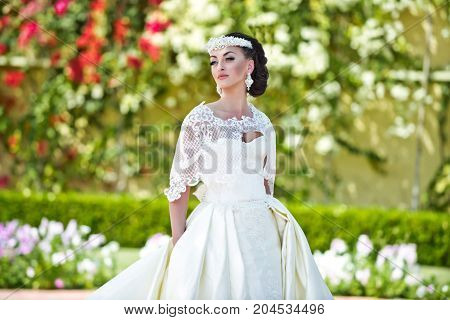 Bride In Wedding Diadem And White Dress On Sunny Day