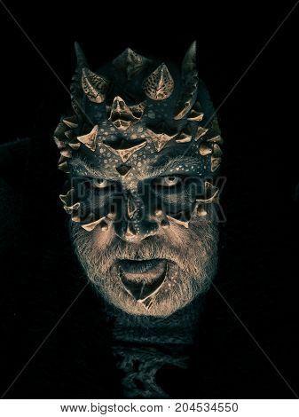 Man With Dragon Skin And Grey Beard
