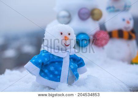 Snowman On White Snowy Background