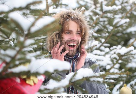 Guy Smiling On Fir Trees On Snowy Nature